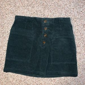 Dark green corduroy mini skirt with brown buttons